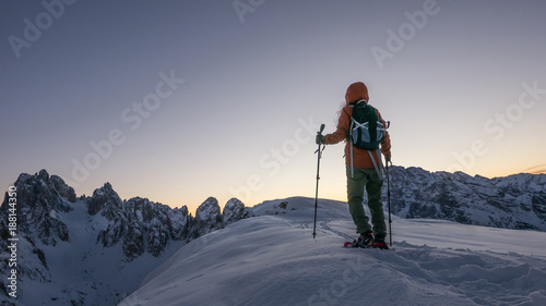 Aluminium Lavendel Inspiring background of young woman exploring the top of the snow capped mountain