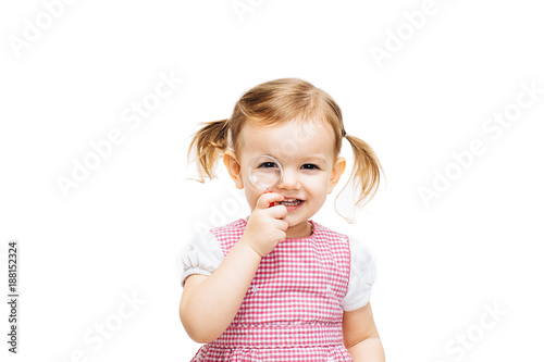 Toddler girl with magnifying glass