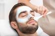 Leinwanddruck Bild - Man having cosmetic mask in spa salon