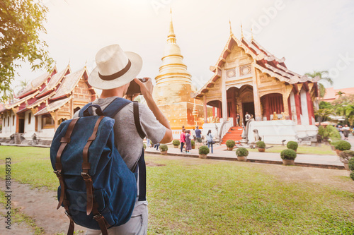 Wall mural travel to Asia, tourist photographer taking photo of temple or landmark, tourism in Thailand