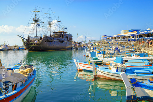 Papiers peints Chypre Pirate ship and fishing boats in harbor of Ayia Napa, Cyprus.