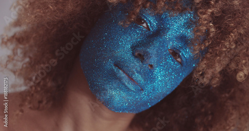 Foto Murales black woman with blond hair and blue glitter face makeup portrait