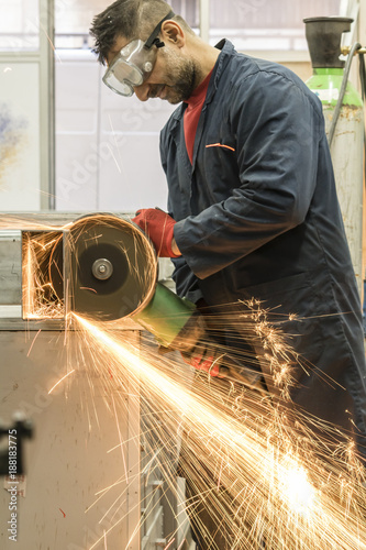 Worker Cutting iron