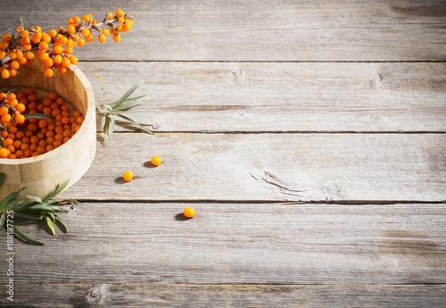 sea buckthorn on wooden background