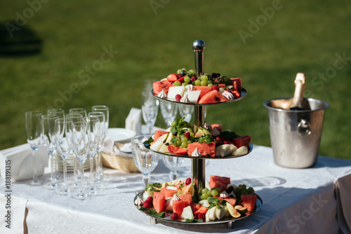 delicious fruit table with different sweets, for wedding reception, catering in restaurant - 188191315