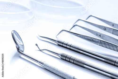 dental tools on white background close up - 188192511