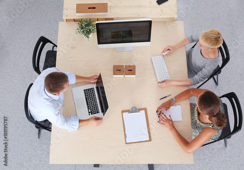 Foto Murales Group of business people working together in office . business people