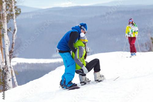 Foto Murales snowboarders on  ski resort
