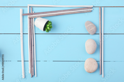 Stones and plant on the wooden background. - 188209755
