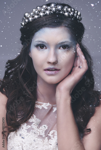 Foto Murales Front view of ice queen among snow falling