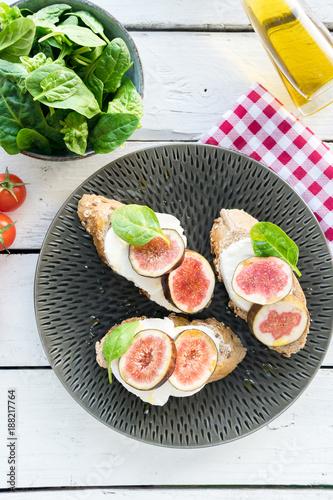 Foto op Canvas Sushi bar fresh ripe sliced fig on toast bread mozzarella cheese Italian crostini dish light lunch starter