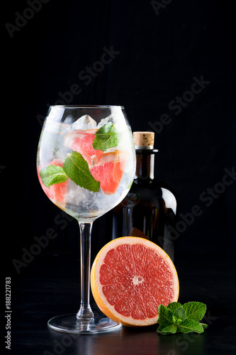 Foto Murales fancy gin and tonic selection drink alcohol cocktail craft fresh fruit spices mint glass bar