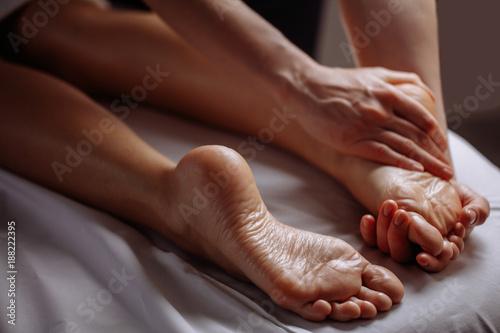 Foot massage in spa salon, close up