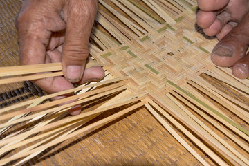 the man working for make bamboo woven