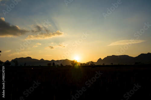 Foto op Canvas Zee zonsondergang Sunset beautiful light with mountain background