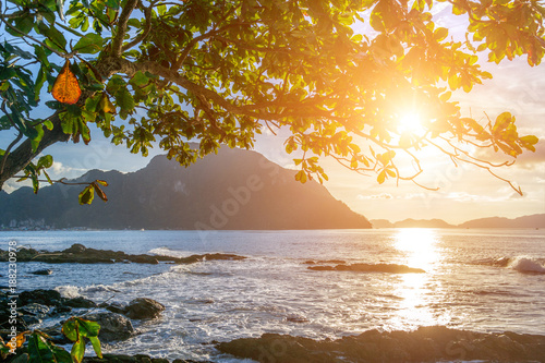Beautiful sunset view on the rocky beach in El Nido, Palawan island, Philippines