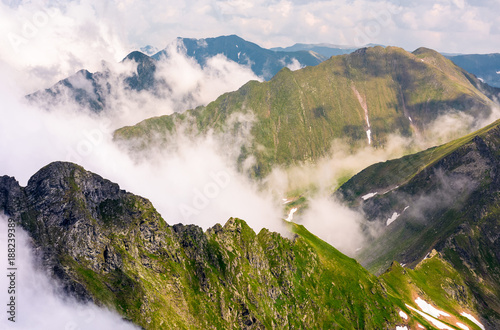 Fotobehang Wit rising clouds over the Fagaras mountains of Romania. gorgeous nature scenery on high latitude in summertime