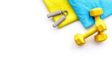 Fitness concept. Dumbbells, towel on white background top view copy space © 9dreamstudio