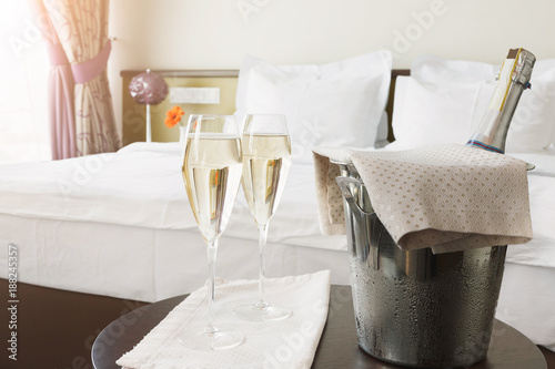 Two glasses and bottle of champagne in hotel
