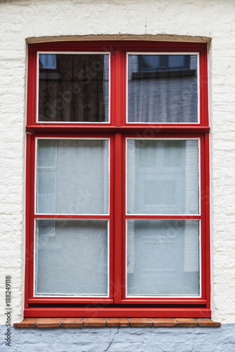 Foto Murales Red window of an old classic building in Bruges, Belgium