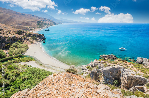 Fototapeta Preveli Beach in Crete island, Greece. There is a palm forest and a river inside the gorge near this beach.