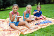 Young girls eating at the park
