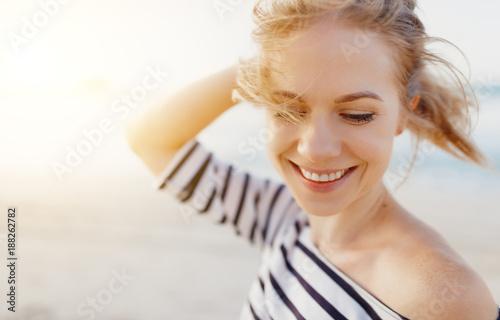 Leinwandbild Motiv happy woman enjoying freedom and laughs on sea