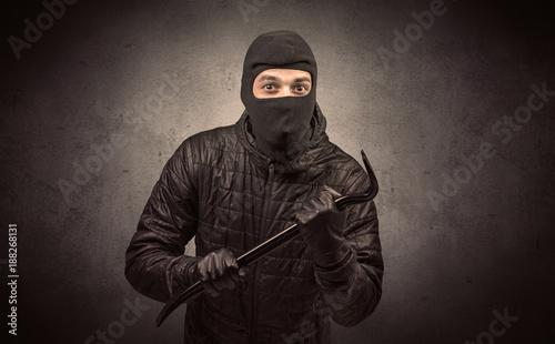 Height scale Burglar with tool.