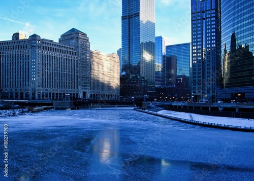 Poster Chicago Frigid, blue morning in Chicago during January freeze with view of a frozen river.