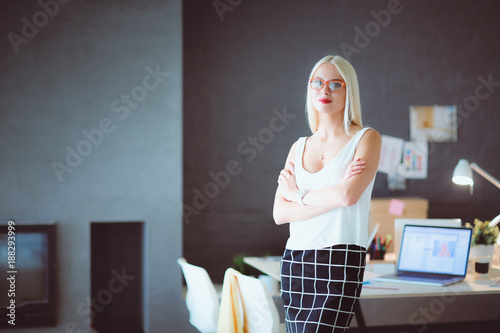 Sticker Portrait of an executive professional mature businesswoman sitting on office