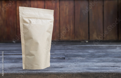 Brown paper bag with space on wood background, tea bag packaging  - 188338542