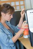 Lady spraying aerosol on computer - 188341547