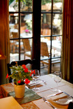 Table near window setting for romantic lunch, restaurant interior - 188343721