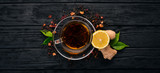 Tea with lemon and ginger. Hot drink On a wooden background. Top view. Copy space. - 188343965