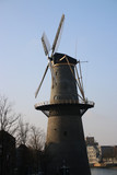 Windmill along river Schie in the city of Schiedam, The Netherlands - 188360740