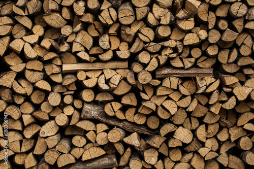 Fotobehang Brandhout textuur Stacked firewood background, logs