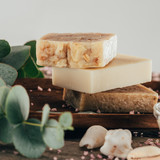 close up of homemade soap and salt for spa on wooden board - 188367162