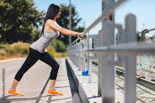 Foto Murales City workout. Beautiful woman training in an urban setting