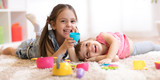 Fototapety Cute funny children playing with dishware toys at home