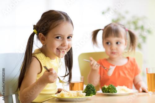 Foto Murales Children eating healthy food in nursery or at home