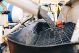 pouring concrete from a concrete mixer to the pump - pouring concrete slab - 188382934