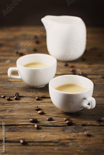 Hot strong coffee on the wooden table