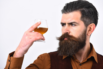 Waiter looks at whiskey or scotch in hand. Restaurant catering concept.
