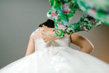 the beautiful girl in a wedding dress - 188406112
