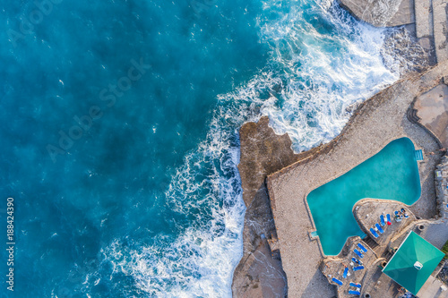 Aerial view of the coast of Montenegro. Storm waves on the Ploče beach.