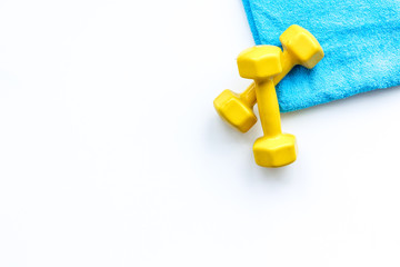 Do fintess in gym. Dumbbells on white background top view space for text pattern © 9dreamstudio
