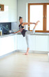 Fitness girl cooking healthy food in the kitchen. Woman. Kitchen. Cooking
