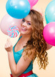 Woman with colorful balloons and lollipop