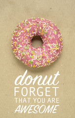 Awesome / Creative valentine concept photo of donut with text on brown background.