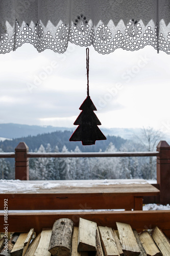 Foto Murales window with winter mountain landscape